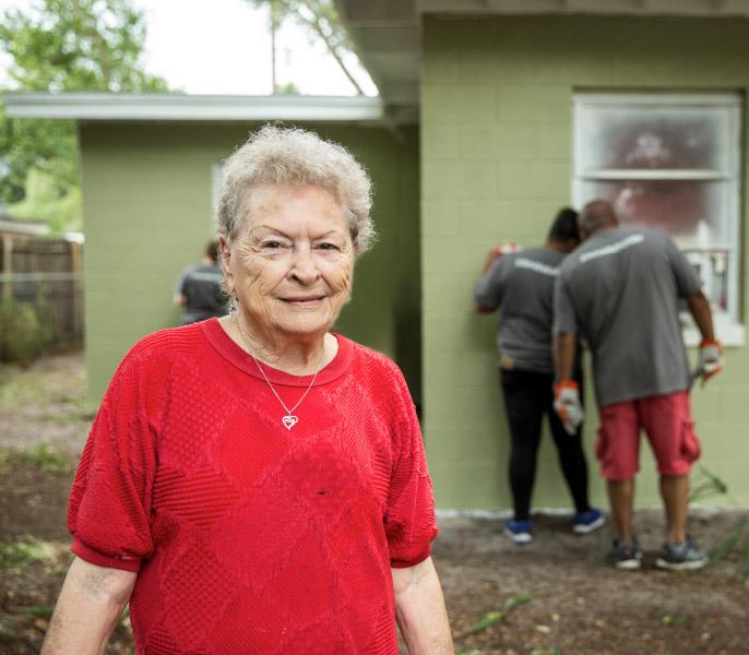 Women appreciative of work being done to her house